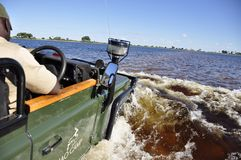 Driving a Landrover through the flodded Okavango Swamps. No risk, no fun: Driving a Landrover through the flodded Okavango Swamps is a adventure stock images