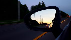 Car Side Mirror View At Night  Vehicle Rear View Of Street