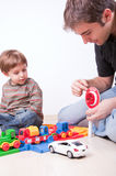 Driving lesson using toys and stop sign Royalty Free Stock Image