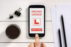 Driving licence app mock up on smart phone screen with office ob Royalty Free Stock Photos