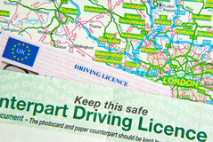 Driving Licence on Map Stock Photography