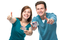 Driving license. Happy teens showing their driving license Stock Images