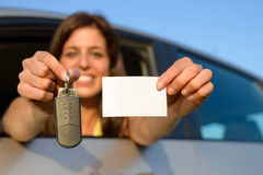 Driving license and car keys. Happy teen girl showing new car keys and driving license Royalty Free Stock Images