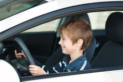 Driving little boy Royalty Free Stock Image
