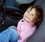 Driving little girl Royalty Free Stock Photos