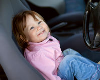Driving little girl Stock Photography