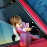 Driving little girl Stock Image