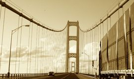 Driving Mackinaw. This is a picture (taken from my car) of the top structure of the Mackinaw bridge, including the bridge cables, several cars and a large truck Royalty Free Stock Photography