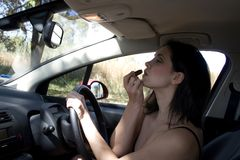 Driving make-up Stock Image