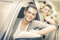 Driving man and children in the car. Driving men and children in the car window stock photography