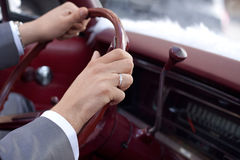 Driving. A man with her hand on the wheel Royalty Free Stock Photo