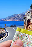 Driving with a map. Driving down the road with a map in hand Stock Photo
