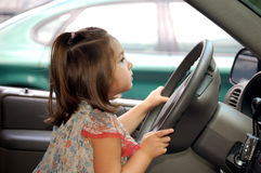 Driving me Crazy. Four year old girl driving a car Stock Photo