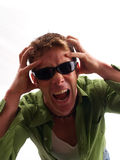 Driving Me Crazy. Blond male casual man with the look of going crazy or stressed out Royalty Free Stock Photos