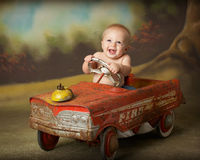 Driving me crazy. Little boy driving antique car Royalty Free Stock Photos