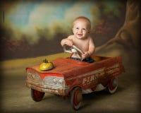 Driving me crazy. Little boy driving antique car Stock Images