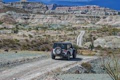 Jeep car in baja california landscape panorama desert road. Driving in Mexico baja california landscape beautiful colors panorama desert road Royalty Free Stock Image