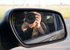 Driving mirror. Driving mirror with photographer reflection Royalty Free Stock Photo
