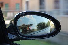 Driving mirror with water drops Stock Photo