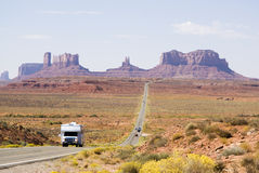 Driving through Monument Valley. Recreational vehicle driving through Monument Valley Stock Photos