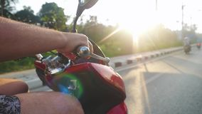 Close up of man driving motorbike on tropical island during beautiful sunset in slow motion while traveling. Thailand stock footage