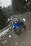 Driving a motorbike in bad weather Royalty Free Stock Image