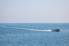 Motorboat on blue sea royalty free stock images