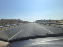 Driving by motorway a sunny quiet day Stock Photos