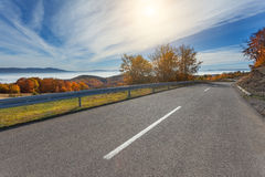 Driving on mountain road at beautiful autumn morning Royalty Free Stock Images