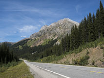 Driving through the Mountains on a road trip. Driving through the mountains on a winding road on a road trip Stock Image