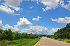 Driving in National Park. On cloud and blue sky background Stock Photography