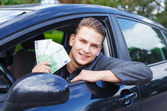 Driving a new car. Portrait of a handsome young man driving a car Stock Photography