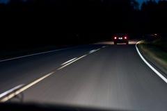 Driving at night royalty free stock photography