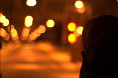 Driving at night. Picture of a bus driver, from behind, at night Royalty Free Stock Photo