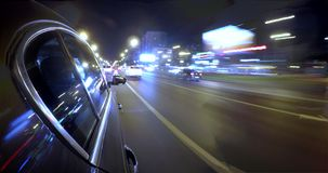 Driving on a night city street at high speed. Blurred motion time lapse. Driving car at high speed through the night city street. Blurred motion time lapse with stock video footage