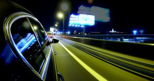 Driving on a night city street at high speed. Blurred motion time lapse. Driving car at high speed through the night city street. Blurred motion time lapse with stock footage