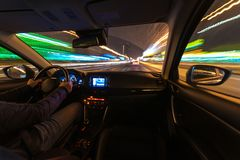 Driving in the night landscape, hands on the wheel. Raindrops. royalty free stock photos