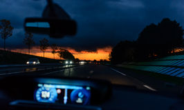 Driving at night at sunset Stock Images
