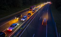 Driving at night, traffic jam go to city, light trails at night Stock Images