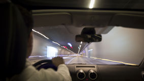 Driving in the night tunnel Royalty Free Stock Image