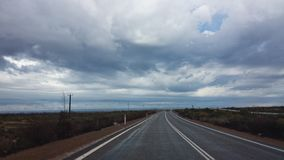 Driving the Nullabor on a highway in the Australian Outback Stock Images