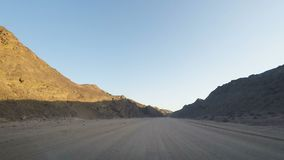 Driving off road on gravel in the Namib Desert, travel destination in Namibia, Africa. View from car mounted camera.  stock footage