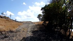 Driving off-road on the windward side of an island in the grenadines stock footage