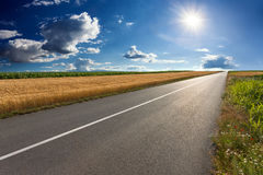 Driving On An Empty Asphalt Road At Sunny Day Royalty Free Stock Image