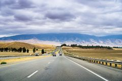 Driving through one of the rural areas of California, close to Bakersfield, on a cloudy day stock photography