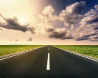 Driving on open asphalt road at idyllic sunny day Royalty Free Stock Photo
