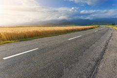 Driving on open road against the sunlight Stock Photo