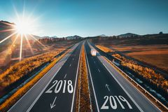 Driving on open road at beautiful sunny day from 2018 to new year 2019. Ae stock photos