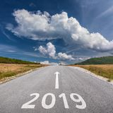 Driving on open road towards the 2019 at sunny day