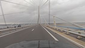 Driving over the Normandy bridge to Le Havre - France stock video